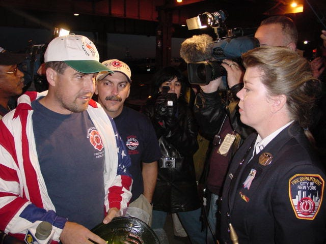Jim Etzin and his contingent presented three commemorative helmets from emergency responders in Michigan to those in New York City once to conclude their bridge-to-bridge walk.