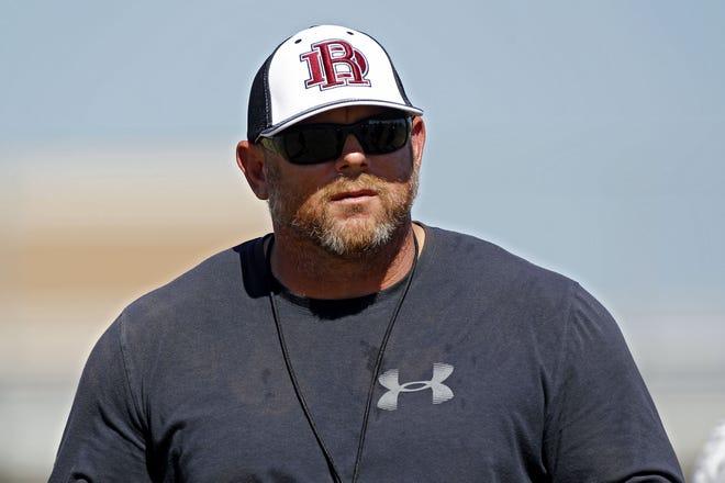 Head coach Jeremy Hathcock of Desert Ridge High School leads practice on Tuesday, Aug. 8, 2017.