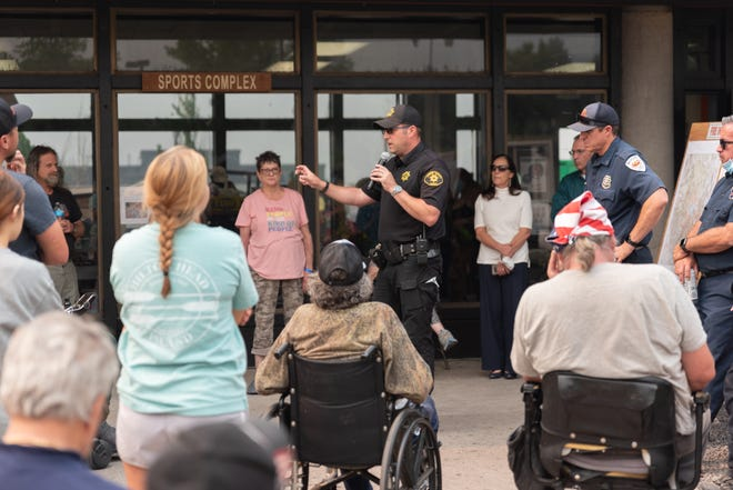 Lassen County Sheriff Dean Growdon speaks to a crowd of over 50 evacuees outside the sports complex at the Lassen Community College, also the evacuation center, on Tuesday.