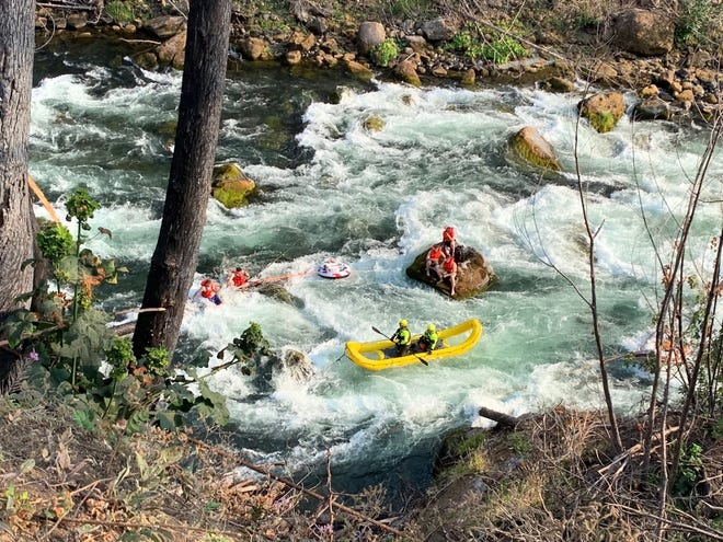 A group of rafters or inner tubers were rescued from the North Santiam River on Sunday.