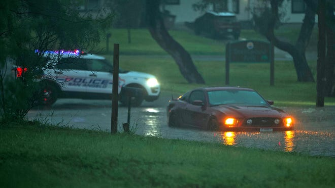 A vehicle sits stranded in high water near Brentwood Park after a storm brought flash flooding and heavy rain to the area Tuesday, Aug. 17, 2021.
