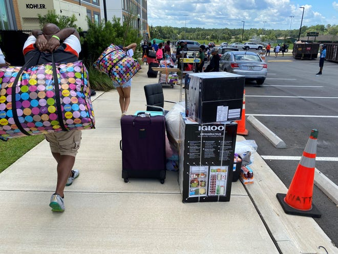 Fathers help with unloading items at freshmen begin moving into the FAMU Towers North on Tuesday, Aug. 17, 2021, at Florida A&M University.