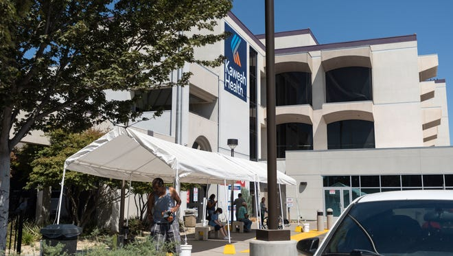 The temporary tents in the parking lot at Kaweah Health Medical Center are part of their response to the recent surge in patients that filled the hospital and left more than 60 patients waiting for admission.