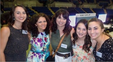 """Friends are seen gathered at a past Jehovah's Witnesses convention when there was an in-person event. The past two years, Jehovah's Witnesses have """"gathered"""" virtually for the world's largest convention due to COVID-19."""