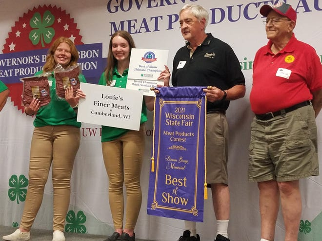 Louie's Finer Meats of Cumberland earned the honor of Wisconsin State Fair Meat products Best of Show  for its entry into the Dried or Smoked Meat division. It sold last week to a consortium of MaryBeth Carr, Wisconsin Souvenir Milkcaps and UW Provision Company, for $2,000 for the benefit of Wisconsin 4-H.  Louie  Muench Jr. , second from right, and Louie Muench, Sr., right, are joined by Emmalyn Sprangers, left, and Adaire MacSwain of the Wisconsin 4-H Leadership Council.