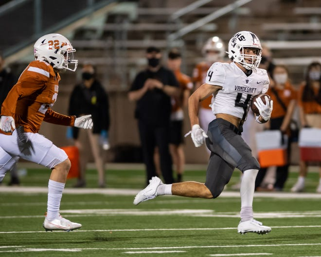 Vandegrift's Ryan Sheppard scampers for a touchdown past Westwood's Drew Goodall in 2020. The hard-nosed runner had more than 1,100 all-purpose yards and eight touchdowns last fall.