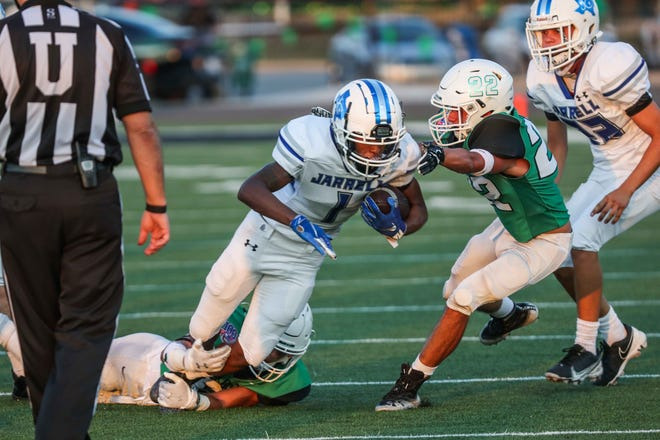 Jarrell's DJ Warren plods forward against Burnet last season. Warren will lead the Cougars' rushing attack after gaining more than 1,200 yards last year.