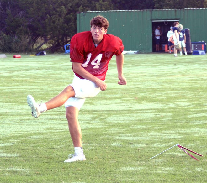 Regents kicker Will Stone gets his work in during Tuesday morning's practice. Stone, one of two Regents seniors committed to play FBS football next season, is committed to Texas.