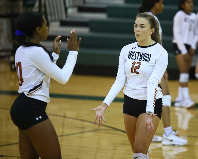 Phia Parent, 12, celebrates a point with Peyton Ferree for the Westwood Warriors against Cedar Park Aug. 17 at Cedar Park High School. The Warriors took the victory in a 3-1 match.