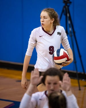 Lauren Murphy gets ready to serve for Round Rock against Troy during the Leander/Georgetown/Eastview Classic volleyball tournament Aug. 14 in Georgetown. Murphy had 18 kills as the Dragons beat Georgetown in a nondistrict game Aug. 17.
