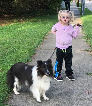 Holly Christensen's daughter, Lyra, with Lily.