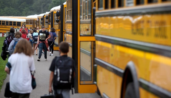 Students rush to their buses at the end of the school day at Tallmadge Middle School, Wednesday, Aug. 18.