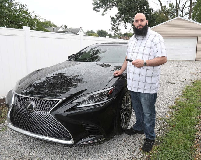 """Shaun """"Rocky"""" Jaber, a member of Barberton City Council, holds a GPS monitoring device he says was illegally placed in the wheel well of his car."""