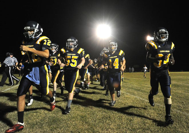 In this photo from 2012, Augusta Prep players leave the field at halftime against Louisville's Thomas Jefferson Academy, in Prep's first home game under the school's new lights.