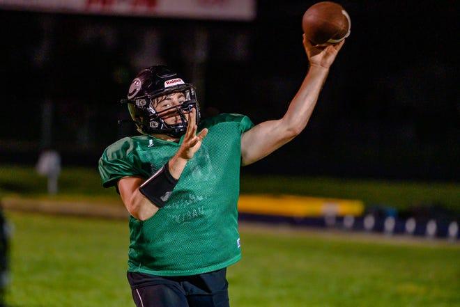 Centralia senior quarterback Beau Gordon throws downfield during passing drills in preseason practice.