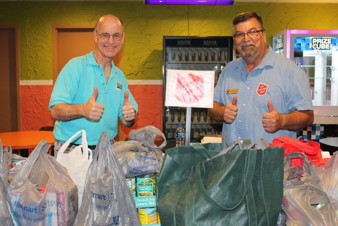 The Cheboygan Salvation Army and Exit Realty Premier hosted a successful fundraiser and donation drive at Spare Time Lanes in 2019, bringing in a large amount of food to help stock the Salvation Army's food pantry. Roger Kopernik of Exit Realty Premier and Roman Hank of the Salvation Army were pleased with the event, so they are holding it again this year.