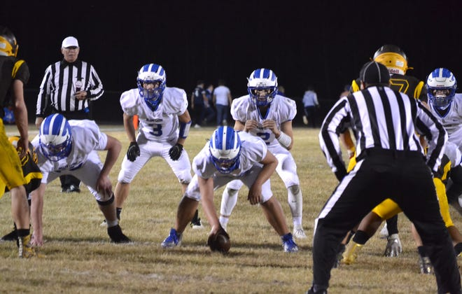 Quarterback Mason Blumke and the Inland Lakes offense gets ready for an upcoming play against the Pellston defense during an 8-Player Division 1 playoff game in Pellston last fall. The Hornets and Bulldogs face off on Friday, Oct. 8, this season.