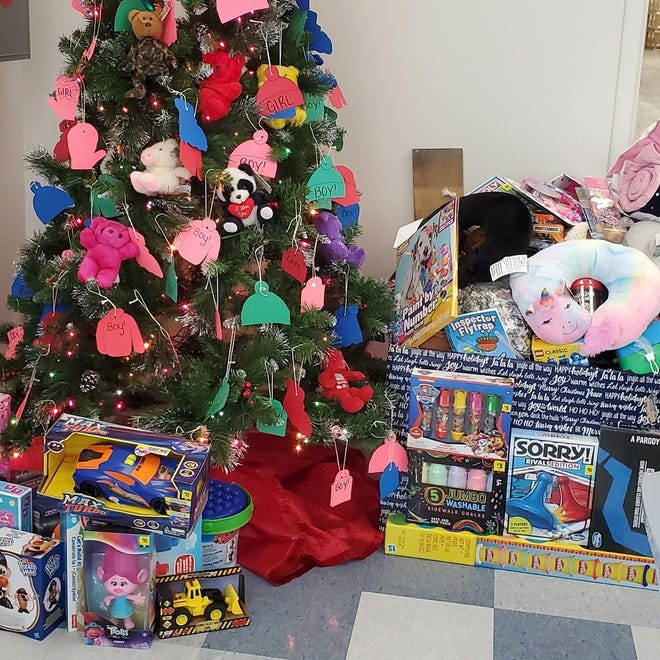 """KanPak's """"Christmas in July"""" luncheon collected over 200 new, unwrapped toys for the Yates Christmas Program."""