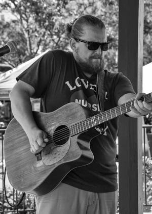 Will Freed, playing earlier this summer at a local festival, has helped thousands cope with COVID in the Central Ohio area.