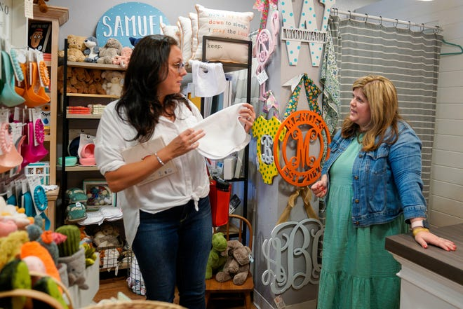 Lauren Bergold, 36, of Tampa, Florida, chats with Hazel + Dot owner Allison Bernardi while shopping for her new baby. U.S. retail sales fell in July by more than forecast, indicating consumers may be growing more price conscious as inflation picks up. (Martha Asencio-Rhine/Tampa Bay Times/TNS)