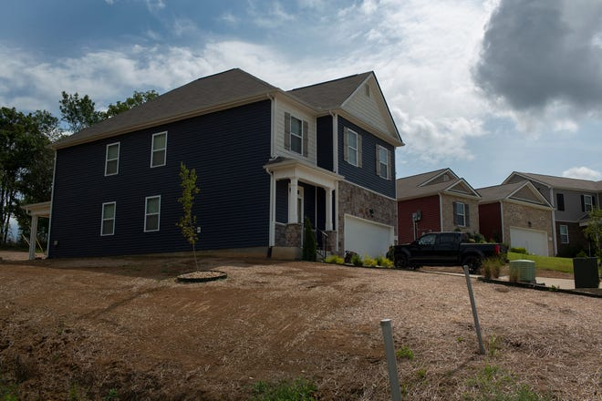 A new home waits for grass located within the Highlands at Bear Creek in Columbia, Tenn., just north of Bear Creek Pike on Wednesday, Aug. 18, 2021.