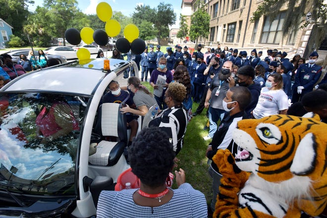 A crowd of well-wishers surround the golf cart with Talen Birt during his visit to Andrew Jackson High School Wednesday morning. Talen Birt, 16, would have been starting his junior year at Andrew Jackson High School this year but the osteosarcoma, a cancer of the bone that he has been fighting since 2019 has progressed too far, and and his medical needs are too many for him to attend school. He and his family received clearance from hospice for him to visit his school, and he was welcomed with a celebration from classmates, cheerleaders, the Air Force Junior ROTC and teachers on the lawn outside the school Wednesday morning.