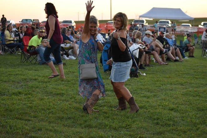 A pair of dancers mug for the camera during the Back Roads Music Festival August 14.