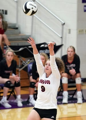 Edgewood's Katie Wilson (9) sets the ball during the Bloomington South-Edgewood volleyball match at South Tuesday evening. (Bobby Goddin/Herald-Times)