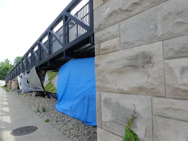 A homeless camp is seen under the B-LIne Trail bridge that passes over West Grimes Lane.