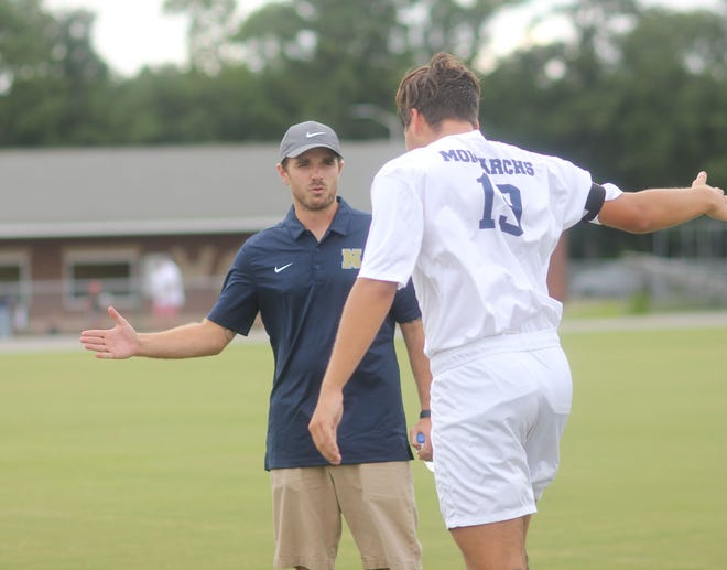 Northside soccer coach Derek Yates wishes his team good luck before a game last week at White Oak.