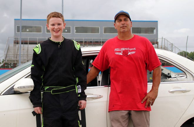 Jacksonville driver Travis Miller, right, and 14-year-old Cody Fink have become quite the friends. On Tuesday, Miller let Fink drive one of his cars around the track.