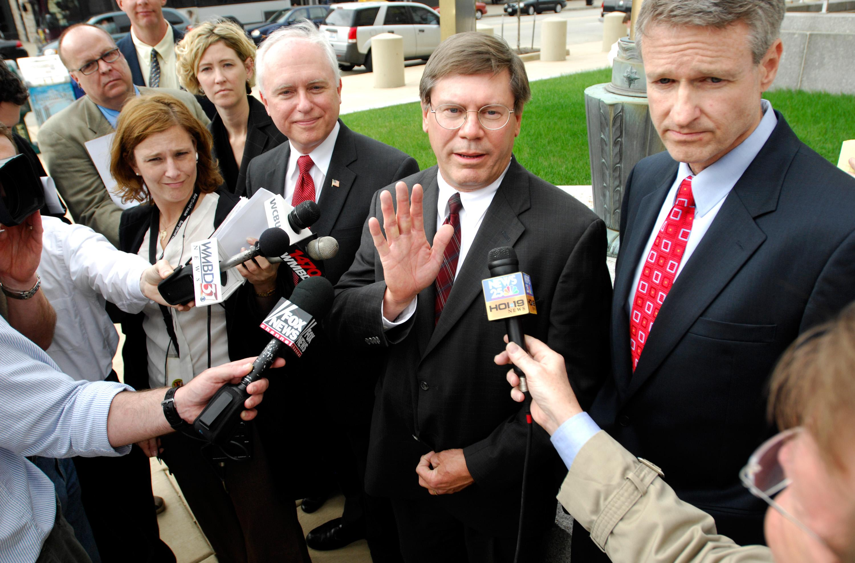 Assistant U.S. Attorney Jeff Lang, center, speaks to the media after Ali al-Marri pleaded guilty April 30, 2009, to a conspiracy count at the U.S. District Courthouse in Peoria. Lang is flanked by Assistant U.S. Attorney David Risley, left, and John Stafford, FBI assistant special agent.