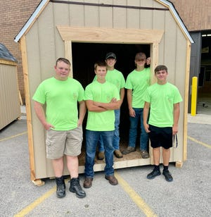 Noah Smith, 17; Hayden Wood, 15; Cole Bushroe, 15,; Isaac Smith, 16; and Christian Koszka-Lombardo, 16, pose with a shed they built during a Skilled Trades Summer Camp held for Monroe County youth.