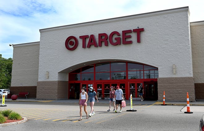 Shoppers exit the Target store on Fortune Boulevard in Milford, Aug. 18, 2021. The retailer has asked for approval for an expansion.