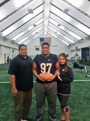 Notre Dame grad senior defensive end Myron Tagovailoa-Amosa, pictured here between his parents, Tuli (left) and Sai, took his recruiting visit to ND very late in the 2017 recruiting cycle.