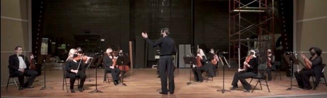 Dan Allcott leads the Oak Ridge Symphony Orchestra strings while masked.