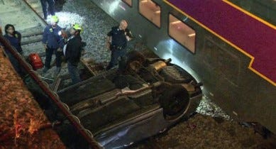 A crash sent a car onto rail tracks in the South End of Boston on Wednesday, Aug. 18, 2021.
