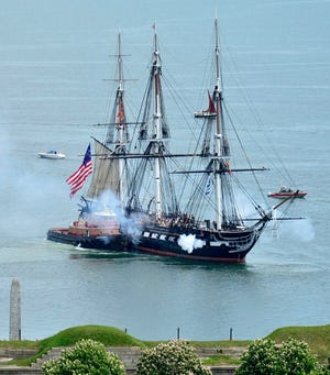 """USS Constitution, the world's oldest commissioned warship afloat, fired its cannons in a 21-gun salute as it was tugged through Boston Harbor in May 2021.The warship earned the nickname """"Old Ironsides"""" during the War of 1812 when British cannonballs were reportedly seen bouncing off the ship's wooden hull."""