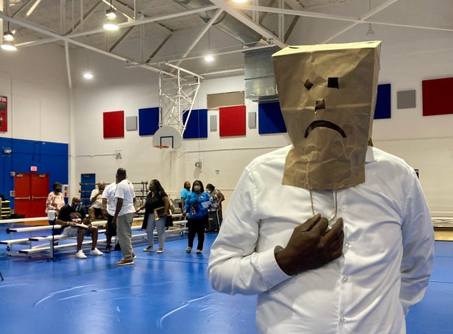 James White, a 22-year Pahokee resident, wore a brown paper bag over his head engraved with a frowning face as he spoke about his concerns in the community at a city gathering on Aug. 16, 2021. RACHIDA HARPER SKINNER/ THE PALM BEACH POST