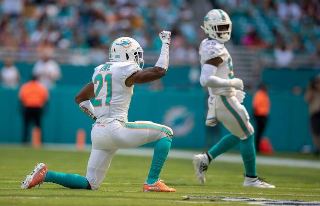 Miami Dolphins cornerback Eric Rowe (21) celebrates breaking up a third down pass to Washington Redskins wide receiver Paul Richardson (10) in Miami Gardens, October 13, 2019.  [ALLEN EYESTONE/The Palm Beach Post]