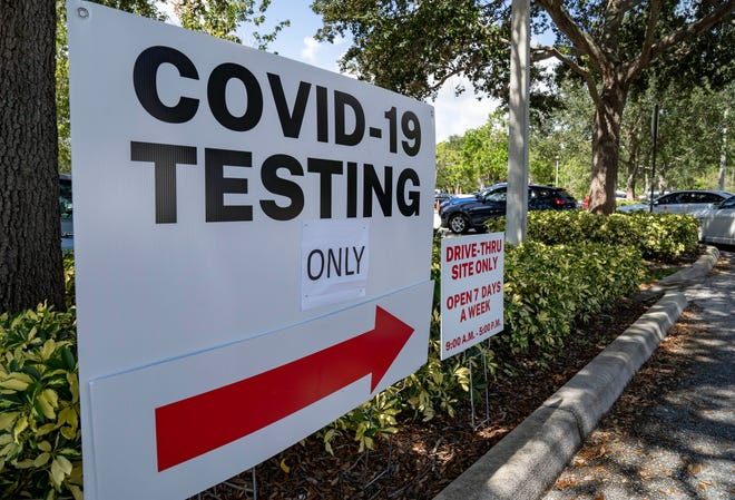 People line up in their cars to get a free COVID-19 test at a site outside the Gardens Branch Library in Palm Beach Gardens, Florida on August 18, 2021. The site is open 7 days a week from 9 am. to 5 pm.