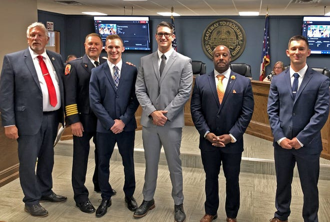 Streetsboro has added new personnel to its fire department. The four new firefighters took their oath before city council on Aug. 9. Pictured is Mayor Glenn Broska (left), Fire Chief Robert Reinholz, Anthony Tomecko, Steve Fernandez, Lamonte Foster and Cole McDougal.