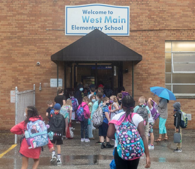 Students enter Ravenna's West Main Elementary School on the first day.