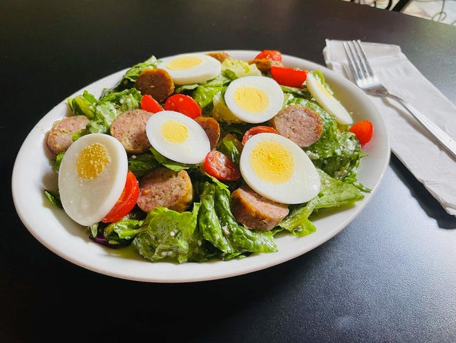 A special salad at Lino's in Rockford, pictured here on  Aug. 11, 2021, is a 40-year-old recipe that includes Romano cheese, Romaine lettuce and a special house dressing made with oil, vinegar and spices.