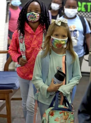Young students are seen wearing masks at school in fall of 2020.