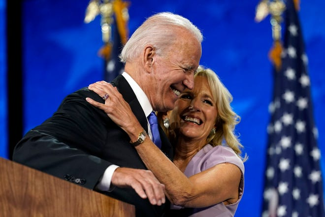 Democratic presidential candidate former Vice President Joe Biden hugs his wife, Jill, after his speech during the fourth day of the Democratic National Convention on Aug. 20, 2020 , at the Chase Center in Wilmington, Delaware.