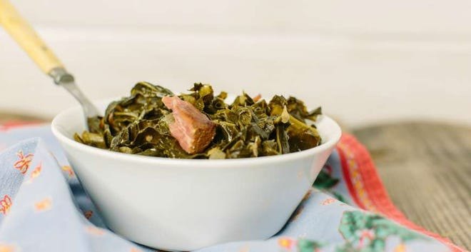 This classic Southern collard greens recipe is chock full of ham hock and its smoky flavor.