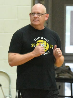 In this StarNews file photo, William 'Hill' Pearsall looks on as the Topsail volleyball team takes on Coastal Christian Tuesday, Aug. 17, 2021. Pearsall is back in the classroom and coaching after he was suspended over a political ideology quiz given out as an optional assignment to his American History class.