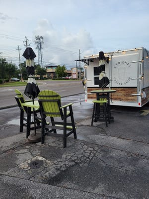 The new Wilmington-based Three Friends Coffee Shop is in a renovated trailer with a double drive-thru and a walk-up window