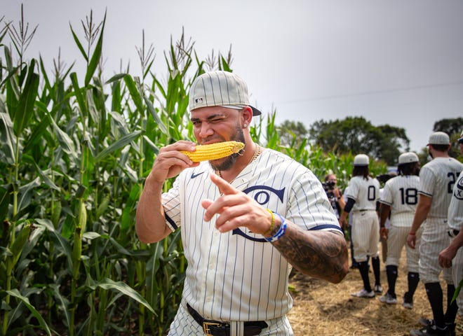 Yoan Moncada of the Chicago White Sox tries an ear of corn Aug. 12 as players tour the Field of Dreams site before the game between the New York Yankees and White Sox outside of Dyersville, Iowa.